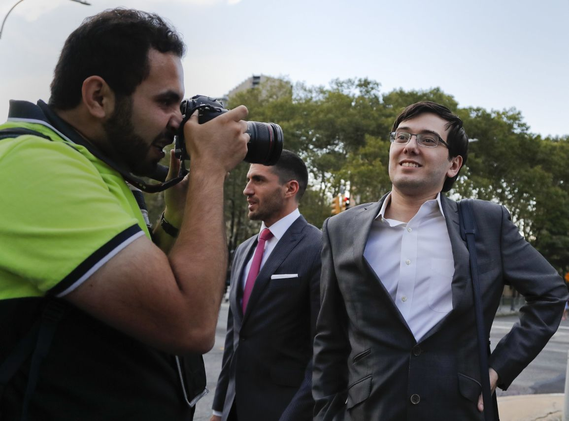 7Former pharmaceutical company CEO Martin Shkreli, right, walks out of federal court with members of his legal team, Thursday, Aug. 3, 2017, in New York. Jurors were on their fourth day of deliberations on Thursday at the securities fraud trial of the former pharmaceutical company CEO. (AP Photo/Julie Jacobson)