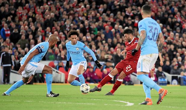 Liverpool's Alex Oxlade-Chamberlain scores his side's second goal of the game during the Champions League quarter final, first leg soccer match between Liverpool and Manchester City at Anfield, Liverpool, England, Wednesday, April 4, 2018. (Peter Byrne/PA via AP) SLOWA KLUCZOWE: soccer;football