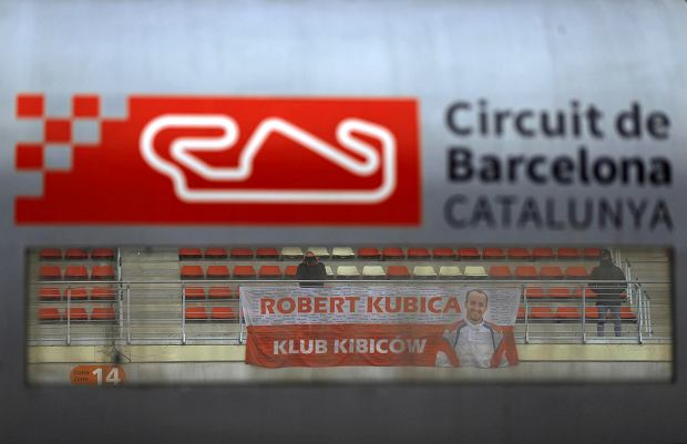 A banner supporting Williams reserve driver Robert Kubica of Poland hangs from the stands during a Formula One pre-season testing session at the Catalunya racetrack in Montmelo, outside Barcelona, Spain, Tuesday, Feb. 27, 2018. (AP Photo/Francisco Seco)