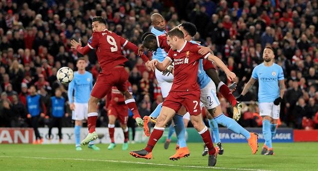 Liverpool's Sadio Mane, center, scores his side's third goal during the Champions League quarter final, first leg soccer match between Liverpool and Manchester City at Anfield, Liverpool, England, Wednesday, April 4, 2018. (Peter Byrne/PA via AP) SLOWA KLUCZOWE: soccer;football