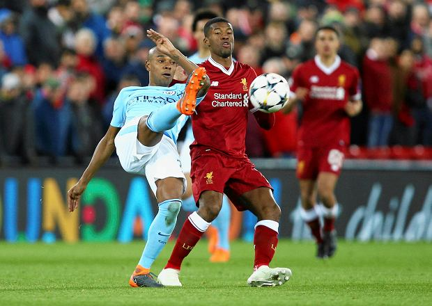 Manchester City's Fernandinho, left, competes for the ball with Liverpool's Georginio Wijnaldum during the Champions League quarter final first leg soccer match between Liverpool and Manchester City at Anfield stadium in Liverpool, England, Wednesday, April 4, 2018. (AP Photo/Dave Thompson) SLOWA KLUCZOWE: XCHAMPIONSLEAGUEX
