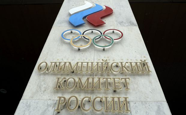 XThe logo of the Russian Olympic Committee is mounted at the entrance of the head office in Moscow, Russia, Wednesday, Dec. 6, 2017. The International Olympic Committee has barred the Russian team from competing at the Winter Olympics in Pyeongchang in February over widespread doping at the last  Winter Games in 2014. (AP Photo/Pavel Golovkin)