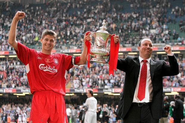 FILE - In this Saturday, May 13, 2006 file photo, Liverpool's Steven Gerrard, left, and manager Rafael Benitez celebrate with the trophy after Liverpool's victory against West Ham United in the FA Cup Final soccer match at the Millennium Stadium in Cardiff, Wales. Gerrard, the former Liverpool and England captain, announced his retirement from professional soccer on Thursday, Nov. 24, 2016 and said he is considering a