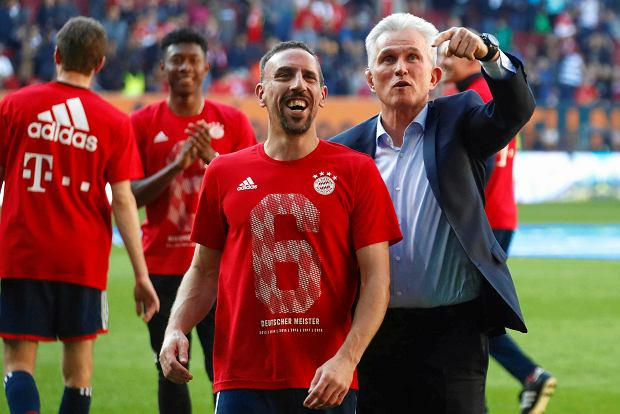 Bayern coach Jupp Heynckes, right, and Franck Ribery celebrate the 28th Bundesliga title after the German Bundesliga soccer match between FC Augsburg and FC Bayern Munich in Augsburg, Germany, Saturday, April 7, 2018. (AP Photo/Matthias Schrader)