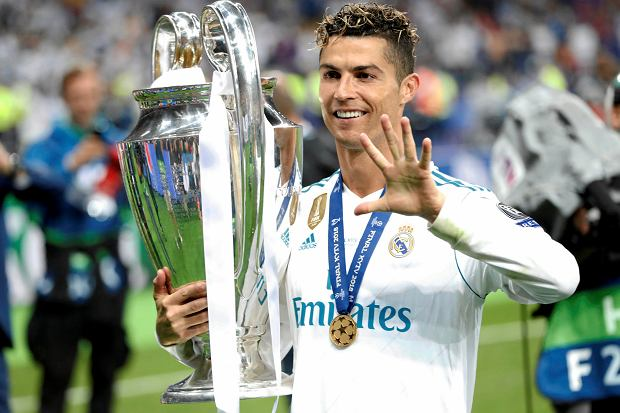 Real Madrid's Cristiano Ronaldo celebrates with the trophy after winning the Champions League Final soccer match between Real Madrid and Liverpool at the Olimpiyskiy Stadium in Kiev, Ukraine, Saturday, May 26, 2018. (AP Photo/Pavel Golovkin)