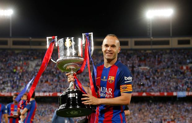 Barcelona's Andres Iniesta poses with the cup after winning the Copa del Rey final soccer match between Barcelona and Alaves at the Vicente Calderon stadium in Madrid, Spain, Saturday May 27, 2017. (AP Photo/Daniel Ochoa de Olza)