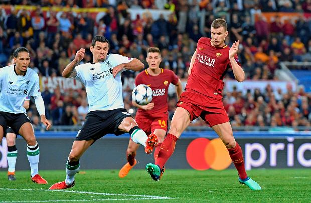 Roma''s Edin Dzeko and Liverpool's Dejan Lovren, left, vie for the ball during the Champions League semifinal second leg soccer match between Roma and Liverpool at the Olympic Stadium in Rome, Wednesday, May 2, 2018. (Ettore Ferrari/ANSA via AP) SLOWA KLUCZOWE: XCHAMPIONSLEAGUEX