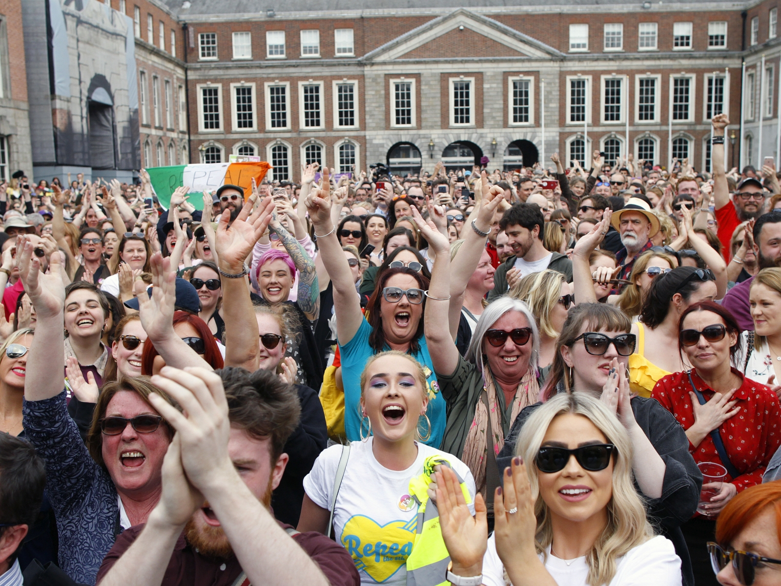 People from the 'Yes' campaign react as the results of the votes begin to come in the Irish referendum on the 8th Amendment of the Irish Constitution at Dublin Castle, in Dublin, Ireland, Saturday May 26, 2018. Abortion rights activists proclaimed victory for Irish women Saturday as referendum results indicated voters in largely Roman Catholic Ireland overwhelmingly backed repealing a 1983 constitutional ban on abortions. (AP Photo/Peter Morrison)