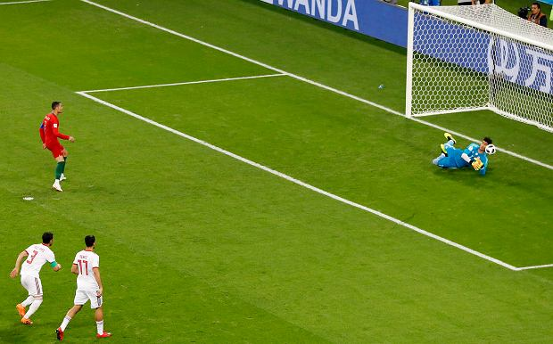 Iran goalkeeper Ali Beiranvand, right, saves a Portugal's Cristiano Ronaldo's penalty kick during the group B match between Iran and Portugal at the 2018 soccer World Cup at the Mordovia Arena in Saransk, Russia, Monday, June 25, 2018. (AP Photo/Darko Bandic) SLOWA KLUCZOWE: WC2018PRT;WC2018IRN