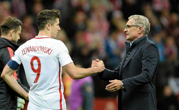 Poland's Robert Lewandowski, left, and coach Adam Nawalka celebrate after winning their last World Cup Group E qualifying soccer match against Montenegro to qualify, at the National Stadium in Warsaw, Poland, Sunday, Oct. 8, 2017. (AP Photo/Alik Keplicz)