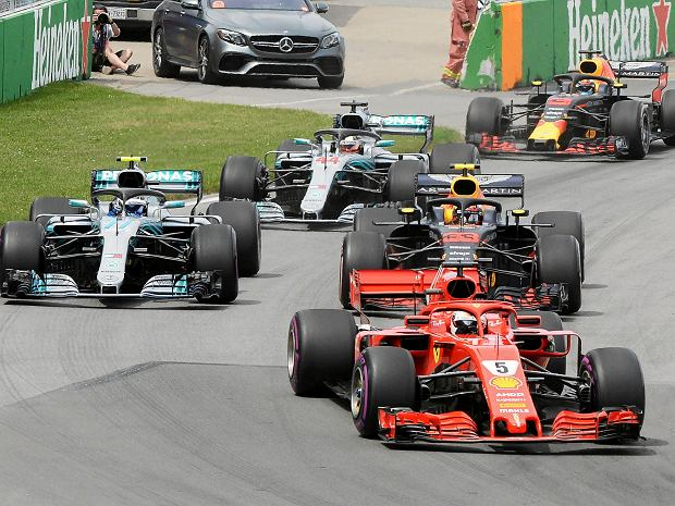 Ferrari driver Sebastian Vettel of Germany leads the pack at the start of the Canadian Grand Prix Sunday, June 10, 2018 in Montreal. (Ryan Remiorz/The Canadian Press via AP) SLOWA KLUCZOWE: Canada Quebec Montreal;car racing;F1;1;auto;automobile;automotive;Canada;Canadian;car;cars;competative;compete;competing;competition;competitions;event;formula;one;pro;professional;race;racing;skill;skills;speed;sport;sporting;sports;track;vehicle;vehicles;Canada Quebec Montreal