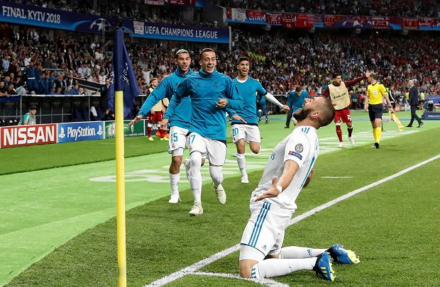 Real Madrid's Karim Benzema celebrates after scoring the opening goal during the Champions League Final soccer match between Real Madrid and Liverpool at the Olimpiyskiy Stadium in Kiev, Ukraine, Saturday, May 26, 2018. (AP Photo/Pavel Golovkin) SLOWA KLUCZOWE: XCHAMPIONSLEAGUEX