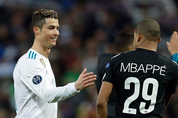 Real Madrid's Cristiano Ronaldo, left, congratulates PSG's Kylian Mbappe at the end of the Champions League Round of 16 first leg soccer match between Real Madrid and Paris Saint Germain at the Santiago Bernabeu stadium in Madrid, Spain, Wednesday, Feb. 14, 2018. Real Madrid defeated PSG 3-1.(AP Photo/Francisco Seco)