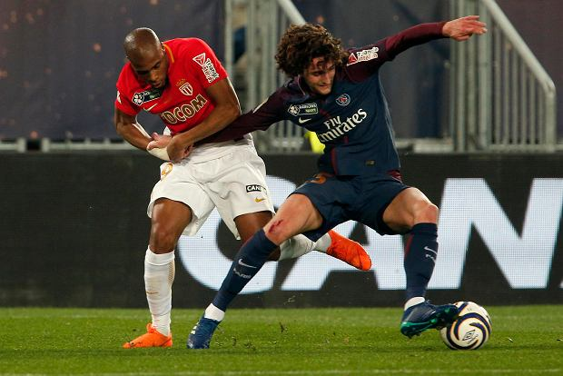 PSG's Adrien Rabiot, right, challenges for the ball with Monaco's Djibril Sidibe during the League Cup final soccer match between Paris Saint Germain and Monaco in Bordeaux, southwestern France, Saturday, March 31, 2018. (AP Photo/Thibault Camus)