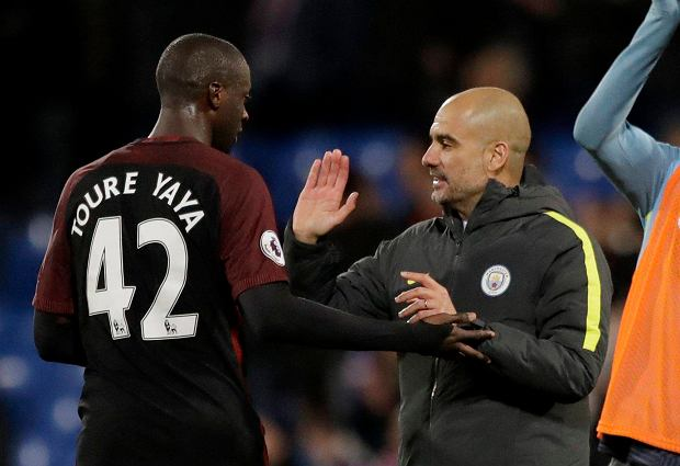 Manchester City's Yaya Toure, who scored both their goals, celebrates with his head coach Pep Guardiola after the English Premier League soccer match between Crystal Palace and Manchester City at Selhurst Park stadium in London, Saturday, Nov. 19, 2016. (AP Photo/Matt Dunham) SLOWA KLUCZOWE: XPREMIERX