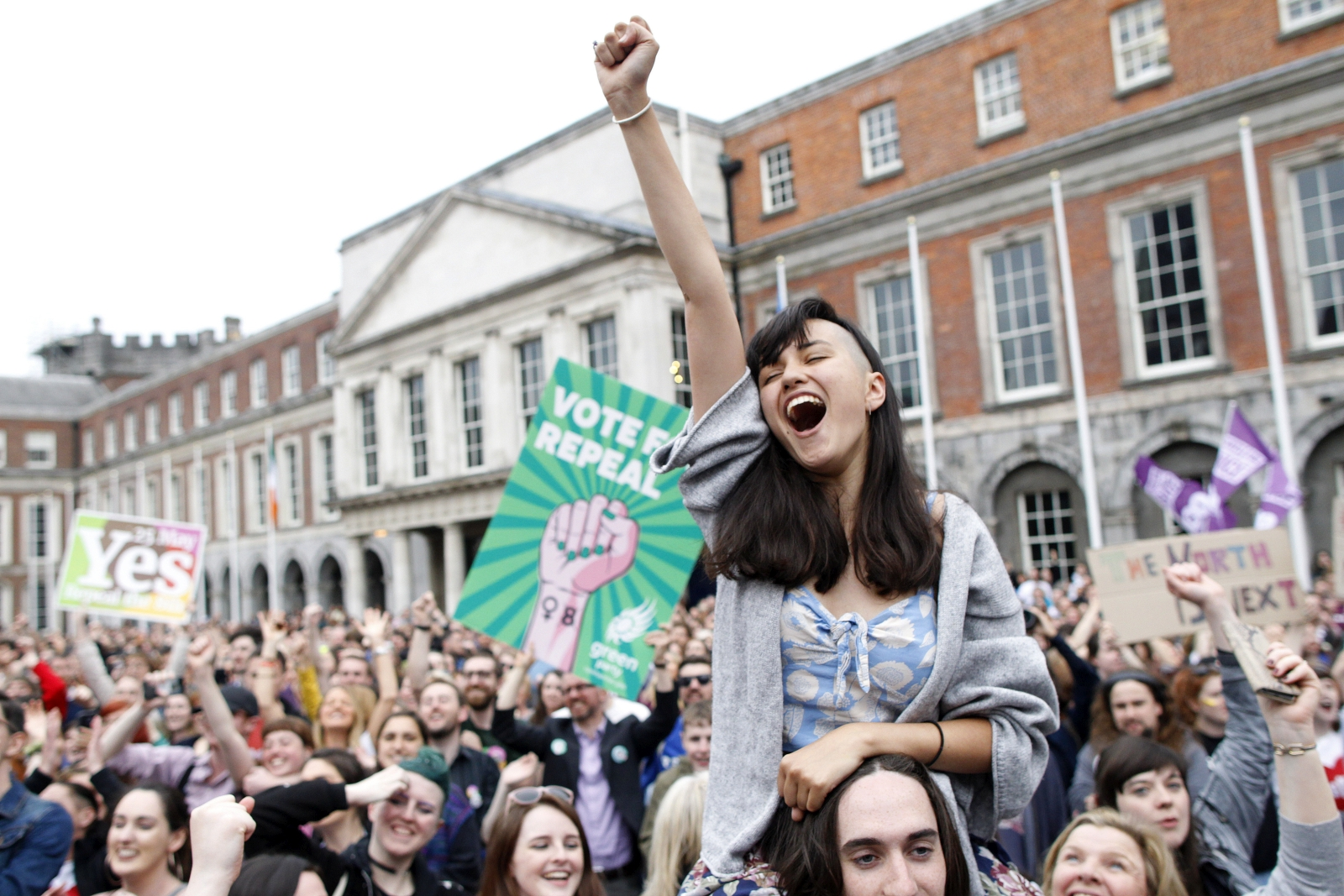 A woman from the'Yes' campaign reacts after the final result was announced, after the Irish referendum on the 8th Amendment of the Irish Constitution at Dublin Castle, in Dublin, Ireland, Saturday May 26, 2018. The prime minister of Ireland says the passage of a referendum paving the way for legalized abortions is a historic day for his country and a great act of democracy. (AP Photo/Peter Morrison)