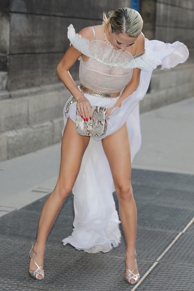 EXCLUSIVE: Caroline Vreeland seen leaving Dior 70th anniversary exhibition party during Haute Couture week in Paris having a Marilyn Monroe moment with double wardrobe malfunction.  Pictured: Caroline Vreeland