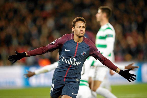 PSG's Neymar celebrates after scoring his side's second goal during a Champions League Group B soccer match between Paris St. Germain and Celtic at the Parc des Princes stadium in Paris, France, Wednesday, Nov. 22, 2017. Banner in the middle reads : Never alone. (AP Photo/Christophe Ena) SLOWA KLUCZOWE: XCHAMPIONSLEAGUEX