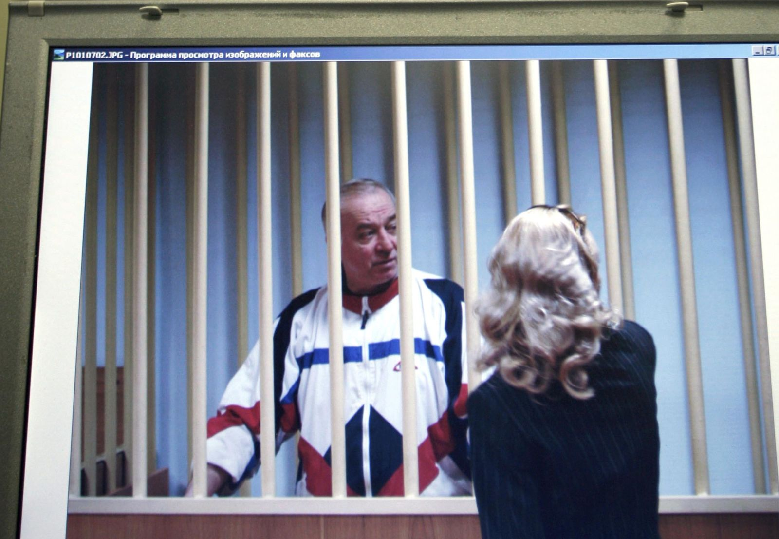rFILE - In this Wednesday, Aug. 9, 2006 file photo, Sergei Skripal speaks to his lawyer from behind bars seen on a screen of a monitor outside a courtroom in Moscow. It has been reported on Monday, March 5, 2018 by the British media that Skripal is in critical condition after exposure to unknown substance in English city of Salisbury. (AP Photo/Misha Japaridze, File)