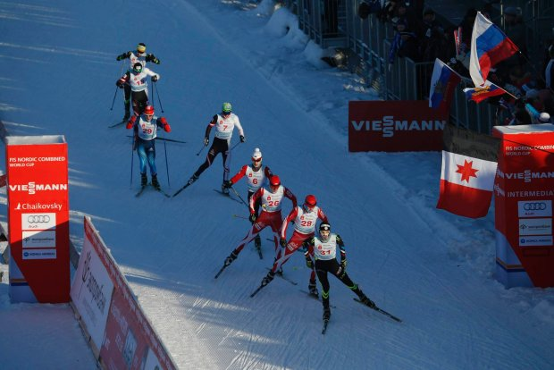 From front to rear, Samuel Guy of France, Adam Cieslar of Poland, Pavel Slowiok of Poland, Karl-August Tiirmaa of Estonia, Franz-Josef Rehrl of Austria and Denis Isaykin of Russia compete during the FIS Nordic Combined World Cup in Chaikovsky, about 1,000 km (621 miles) east of Moscow, Russia, Saturday, Jan. 4, 2014. (AP Photo/Pavel Golovkin)
