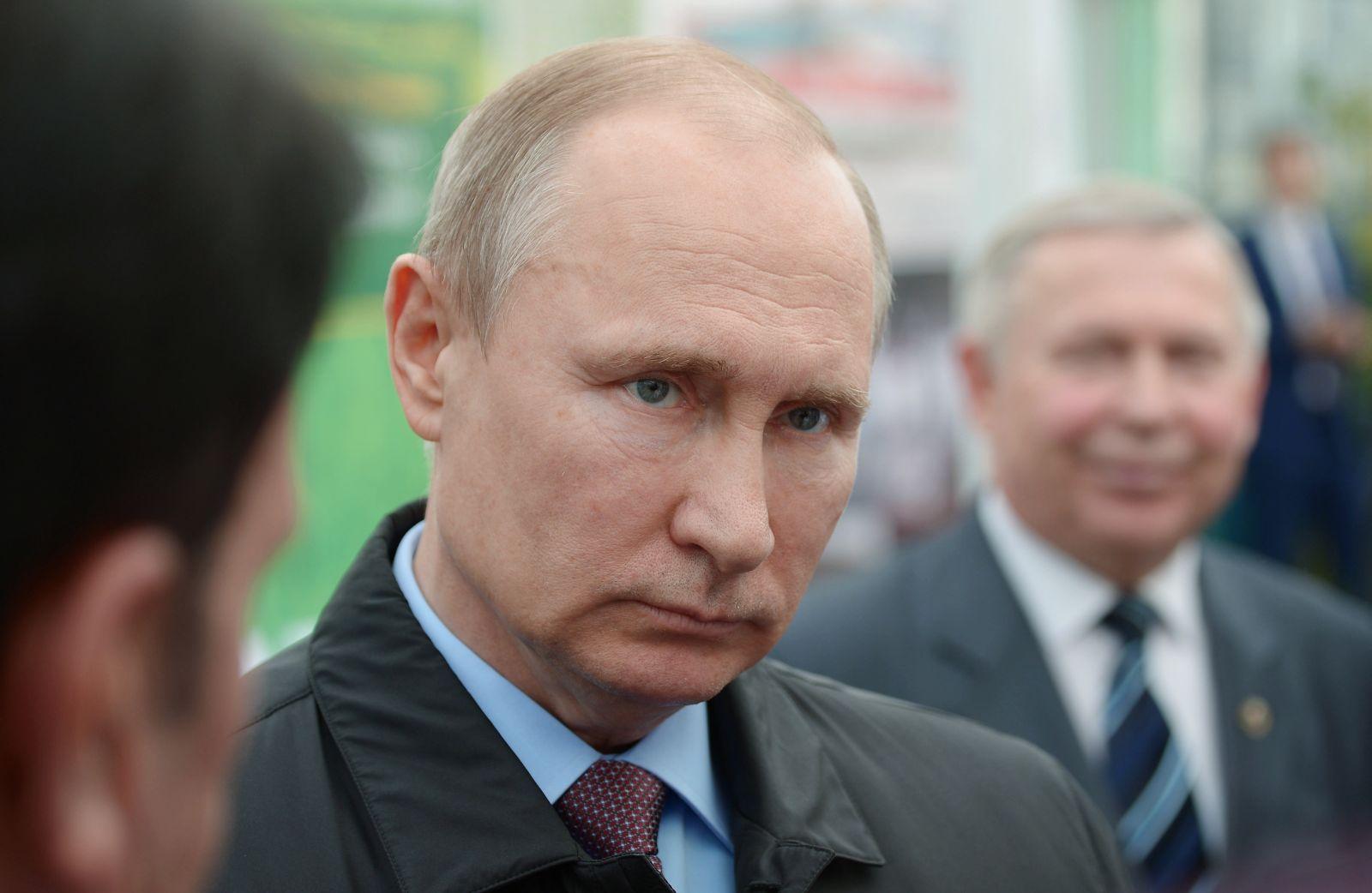 Russian President Vladimir Putin listens to employees of the Lukyanenko National Grain Center in Krasnodar, Russia, Monday, March 12, 2018. (Alexei Nikolsky, Sputnik, Kremlin Pool Photo via AP)