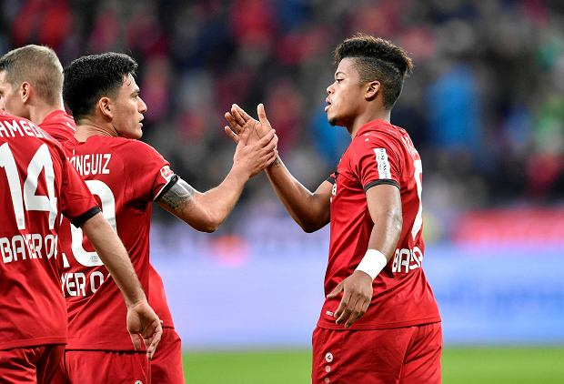 Leverkusen's Leon Bailey, right, is celebrated after scoring his side's first goal during the German Bundesliga soccer match between Bayer Leverkusen and RB Leipzig in Leverkusen, Germany, Saturday, Nov. 18, 2017. (AP Photo/Martin Meissner)