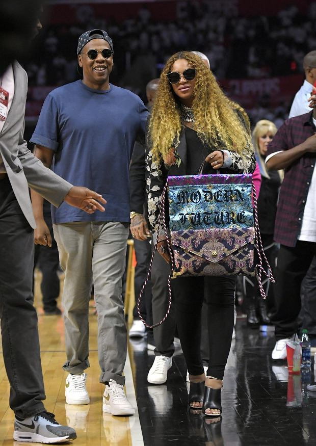 Jay Z, left, and Beyonce leave the court after Game 7 of an NBA basketball first-round playoff series between the Los Angeles Clippers and the Utah Jazz, Sunday, April 30, 2017, in Los Angeles. (AP Photo/Mark J. Terrill)