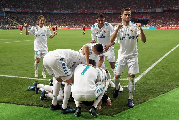 Madrid teammates celebrate after scoring during the Champions League Final soccer match between Real Madrid and Liverpool at the Olimpiyskiy Stadium in Kiev, Ukraine, Saturday, May 26, 2018. (AP Photo/Sergei Grits) SLOWA KLUCZOWE: XCHAMPIONSLEAGUEX