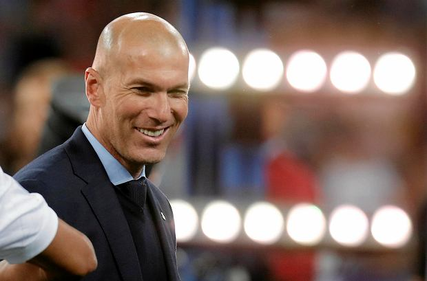 Real Madrid coach Zinedine Zidane smiles after winning the Champions League Final soccer match between Real Madrid and Liverpool at the Olimpiyskiy Stadium in Kiev, Ukraine, Saturday, May 26, 2018. (AP Photo/Efrem Lukatsky)