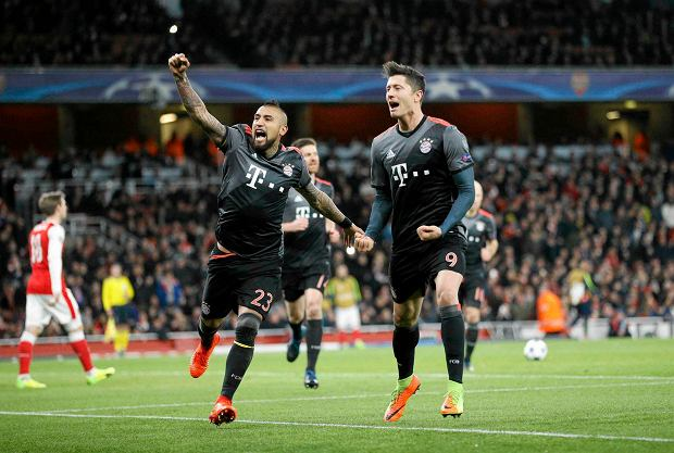 Bayern's Robert Lewandowski celebrates with Arturo Vidal, left, after scoring a penalty during the Champions League round of 16 second leg soccer match between Arsenal and Bayern Munich at the Emirates Stadium in London, Tuesday, March 7, 2017. (AP Photo/Frank Augstein)