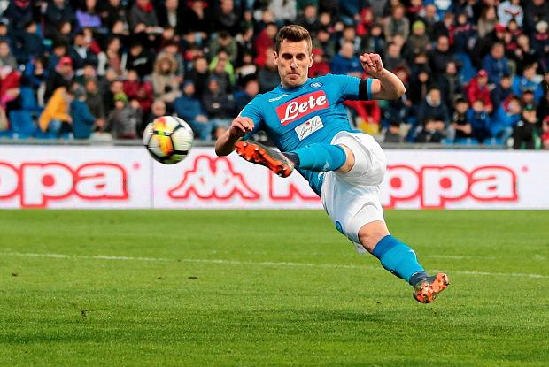 Napoli's Arkadiusz Milik shoots the ball during the Italian Serie A soccer match between Sassuolo and Napoli at the Mapei Stadium in Reggio Emilia, Italy, Saturday, March 31, 2018. (Elisabetta Baracchi/ANSA via AP)
