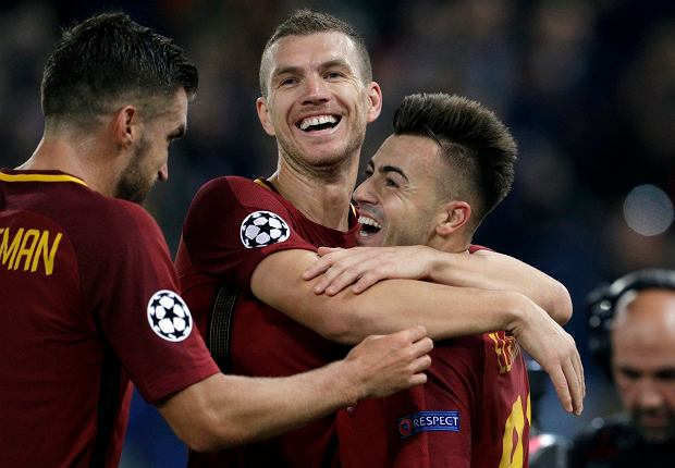Roma's Stephan El Shaarawy, right, celebrates with Edin Dzeko, center, and Kevin Strootman after scoring his side's second goal during the Champions League group C soccer match between Roma and Chelsea, at the Olympic stadium in Rome, Tuesday, Oct. 31, 2017. (AP Photo/Andrew Medichini) SLOWA KLUCZOWE: XCHAMPIONSLEAGUEX
