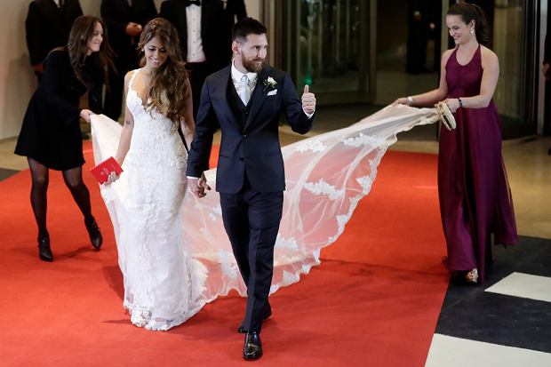 Newlywed Lionel Messi flashes a thumbs up as he and his bride Antonella Roccuzzo come out on to a red carpet to pose for photographers, after tying the knot in a civil ceremony in Rosario, Argentina, Friday, June 30, 2017. About 250 guests, including teammates and former teammates of the Barcelona star, attended the highly anticipated ceremony.(AP Photo/Victor R. Caivano)