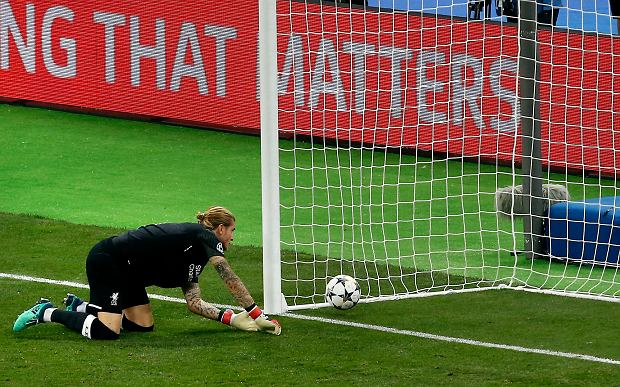 Liverpool goalkeeper Loris Karius looks at the ball after Real Madrid's Gareth Bale scored his side's 2nd goal during the Champions League Final soccer match between Real Madrid and Liverpool at the Olimpiyskiy Stadium in Kiev, Ukraine, Saturday, May 26, 2018. (AP Photo/Darko Vojinovic)