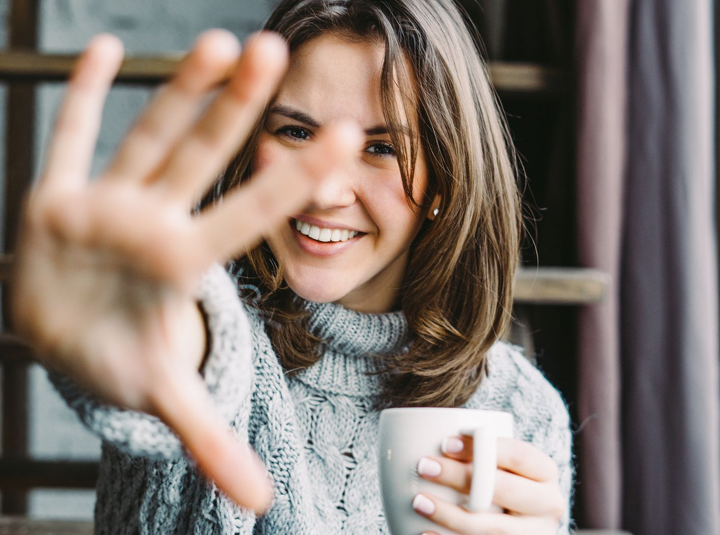 0Happy young woman drinking coffee in the morning