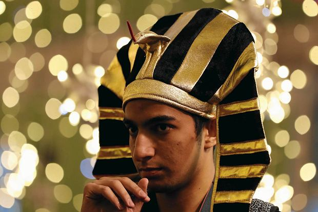 An Egypt fan wears a pharaoh headdress as fans from participating countries gathered to celebrate and cheer on their teams on the eve of the 2018 soccer World Cup, on Nikolskaya Street in Moscow, Russia, Wednesday, June 13, 2018. (AP Photo/Rebecca Blackwell)