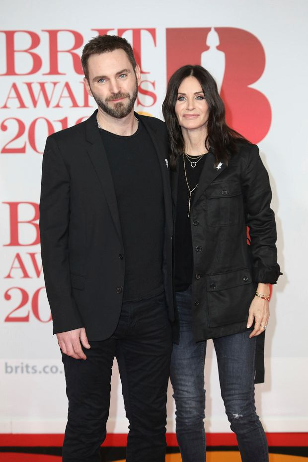 Singer Johnny McDaid, left, and actress Courteney Cox pose for photographers upon arrival at the Brit Awards 2018 in London, Wednesday, Feb. 21, 2018. (Photo by Vianney Le Caer/Invision/AP)