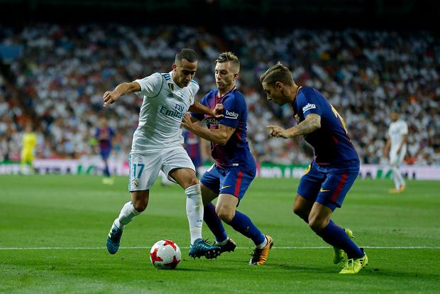Real Madrid's Lucas Vazquez, left, in action with Barcelona's Gerard Deulofeu, centre, and Lucas Digne during the Spanish Super Cup second leg soccer match between Real Madrid and Barcelona at the Santiago Bernabeu stadium in Madrid, Thursday, Aug. 17, 2017. (AP Photo/Francisco Seco)