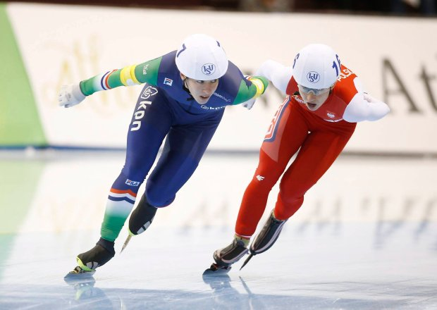 Janneke Ensing (7) of the Netherlands, and Luiza Zlotkowska, (16) of Poland, skate in the women's mass start race at the World Cup Speedskating event Sunday, Nov. 22, 2015, in Kearns, Utah. (AP Photo/George Frey)