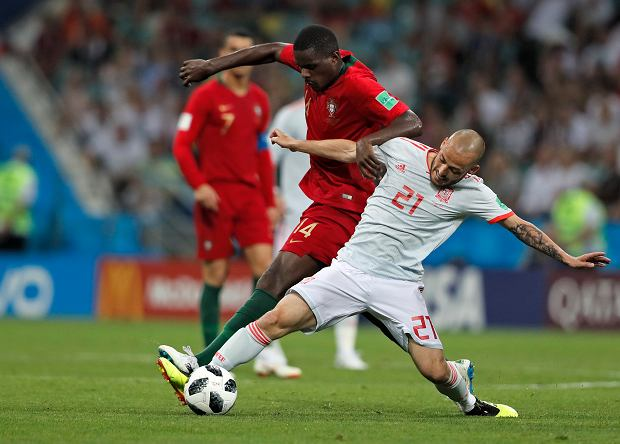 Portugal's William and Spain's David Silva challenge for the ball during the group B match between Portugal and Spain at the 2018 soccer World Cup in the Fisht Stadium in Sochi, Russia, Friday, June 15, 2018. (AP Photo/Frank Augstein)