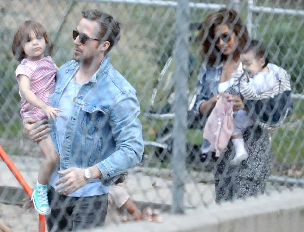 *PREMIUM-EXCLUSIVE* ** RIGHTS: WORLDWIDE EXCEPT IN ITALY ** Los Angeles, CA  - Ryan Gosling and Eva Mendes take the their two daughters, Esmeralda and Amada, to the park. The parents watch their oldest, Esmeralda, play on the jungle gym while Eva holds little Amada.  Pictured: Ryan Gosling, Eva Mendes  BACKGRID USA 18 MAY 2017   BYLINE MUST READ: Vasquez-Max Lopes / BACKGRID  USA: +1 310 798 9111 / usasales@backgrid.com  UK: +44 208 344 2007 / uksales@backgrid.com  *UK Clients - Pictures Containing Children Please Pixelate Face Prior To Publication*