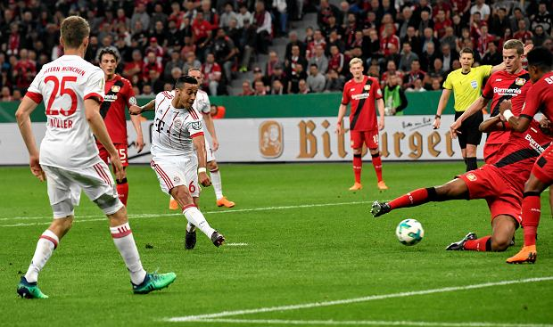 Bayern's Thiago scores his side's 4th goal during the German soccer cup semifinal match between Bayer Leverkusen and Bayern Munich in Leverkusen, Germany, Tuesday, April 17, 2018. (AP Photo/Martin Meissner)