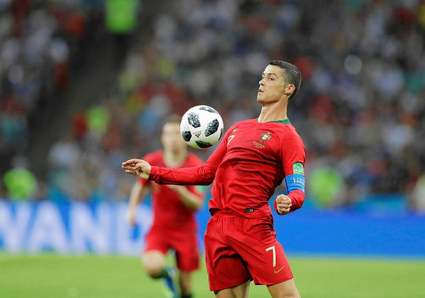Portugal's Cristiano Ronaldo controls the ball during the group B match between Portugal and Spain at the 2018 soccer World Cup in the Fisht Stadium in Sochi, Russia, Friday, June 15, 2018. (AP Photo/Sergei Grits) SLOWA KLUCZOWE: WC2018ESP;WC2018PRT