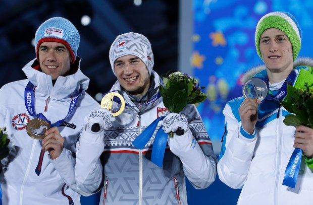 Men's normal hill ski jumping medalists, from left, Norway's Anders Bardal, bronze, Poland's Kamil Stoch, gold, and Slovenia's Peter Prevc, silver, pose with their medals at the 2014 Winter Olympics in Sochi, Russia, Monday, Feb. 10, 2014.  (AP Photo/Morry Gash)