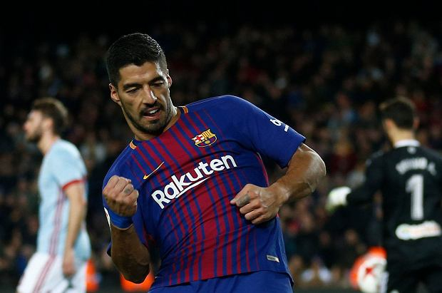 FC Barcelona's Luis Suarez celebrates after scoring during the Spanish Copa del Rey round of 16 second leg soccer match between FC Barcelona and Celta de Vigo at the Camp Nou stadium in Barcelona, Spain, Thursday, Jan. 11, 2018. (AP Photo/Manu Fernandez)